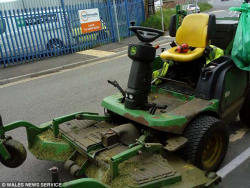 Grass Clipping - Lawn Mower Driver Caught on the Phone